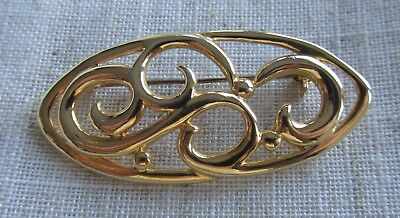 Vintage gold tone abstract brooch