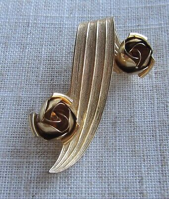 Vintage gold tone abstract brooch with roses