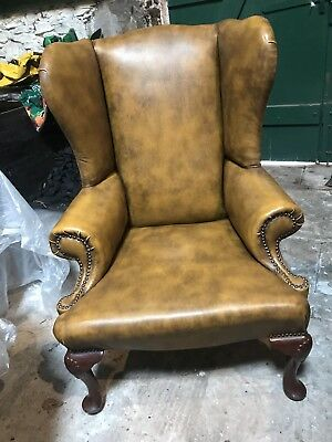 A bespoke hand-built Late C20th replica of a George III wing backed arm chair.