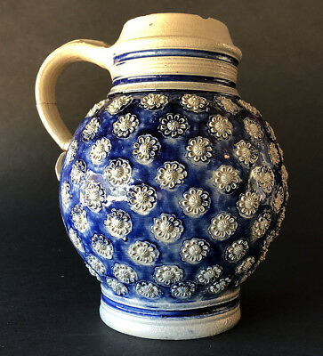 Fine early WESTERWALD saltglazed stoneware flower-head TAVERN JUG, 1700