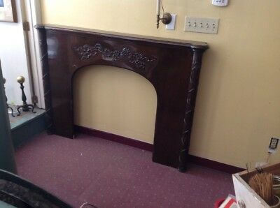 Beautiful vintage Dark wood carved fire place mantle.