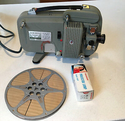Vintage Hanimex Sekonic80P projector with case, spare bulb, and spare drive band