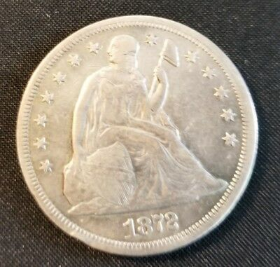 1872 Seated Liberty silver Dollar circulated edge bump nice condition