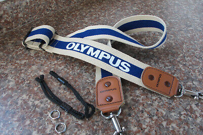 OLYMPUS OM HUNTER CAMERA STRAP with camera attachment rings and cords.