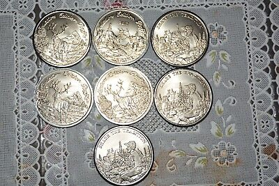 4 Mule Deer Foundation Collectors Edition Coins + 3 Muley Coins Numbered