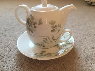 Teapot and cup set by Laura Ashley