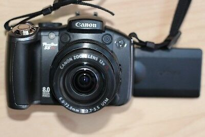 CANON POWERSHOT S5 is CAMERA WITH CASE AND 2GB CARD
