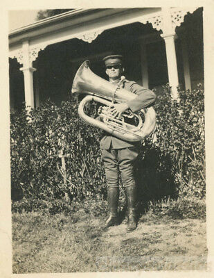 1918 Soldier by House Holds Very Large Tuba Music Instrument