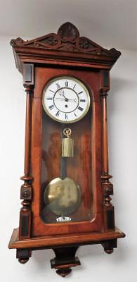 small sized walnut cased single weight vienna wall clock