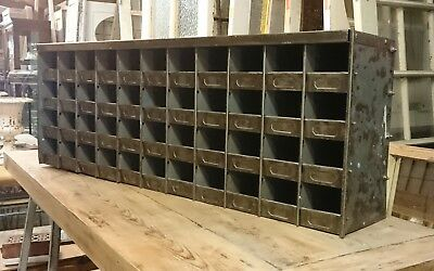 A RECLAIMED STRIPPED AND LAQCUERED INDUSTRIAL CUBBY / PIGEON HOLE UNIT ref 1109
