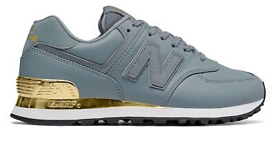 outlet store 416cc 1faac New Balance Women s 574 Gold Dip Shoes Grey with Gold