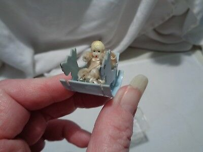 vintage possibly OOAK miniature scottie celluloid shoofly with tiny ceramic doll