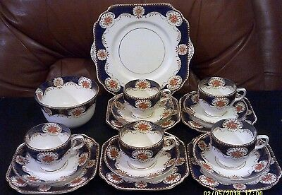 Gladstone 2041 17 Piece Part Tea Set,White,Blue with Red Embossed Floral Pattern