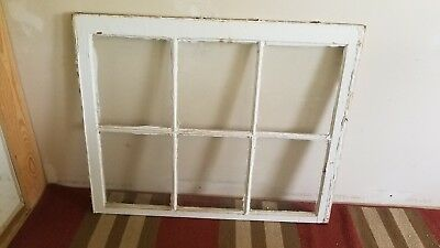 Vintage white wood windows with 6 pane glass.