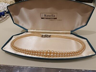 Pair of vintage pearls boxed two strands