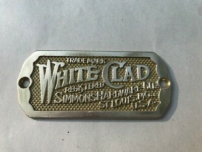 VINTAGE BRASS WHITE CLAD ICEBOX PLAQUE registered Simmons Hardware Co, St Louis