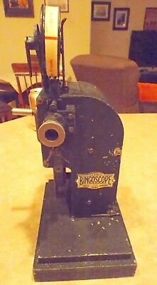 Vintage and complete 1937 BingoScope 9.5mm projector with 7 Pathe Baby Films