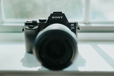 Sony Alpha a7S with Sony 28-70 f/3.5-5.6, 3 chargers, and 5 batteries