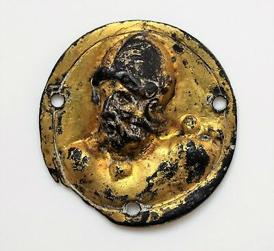 Italian Renaissance: Bronze-gilt decorative plaquette of a helmeted male head.