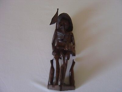 Hard wood oriental carving man in a hat with 3 geese
