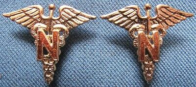 """Pair of WWII US Army Nurse Corps branch insignia with brown enamel """"N's"""""""