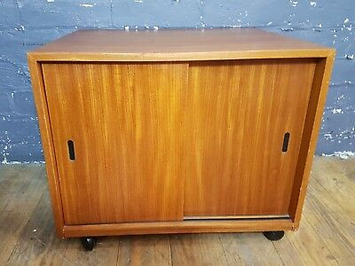 Retro teak Record Cabinet with sliding doors on casters possible coffee table