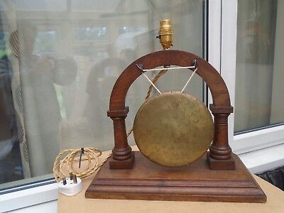 large antique table gong lamp with wooden stand    interesting clearance find
