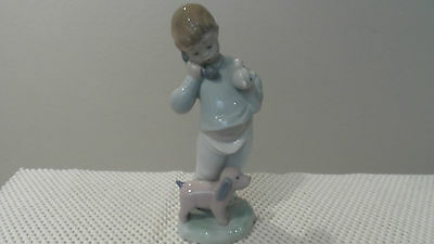 Nao By Lladro Boy On Phone With Puppy Figure