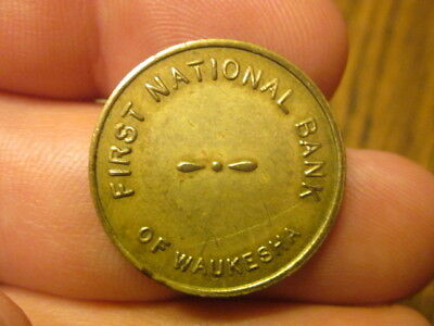 First National Bank of Waukesha, WI vintage solid brass parking token
