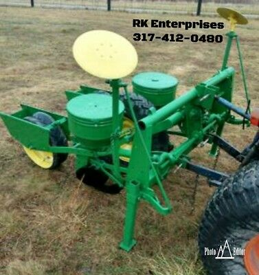 John Deere 2 Row Corn Planter with 3 sets of plates. Can ship
