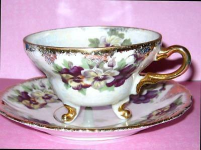 JAPAN 3 FOOTED Tea Cup and Saucer PURPLE PANSY FLORAL Iridescent TEACUP