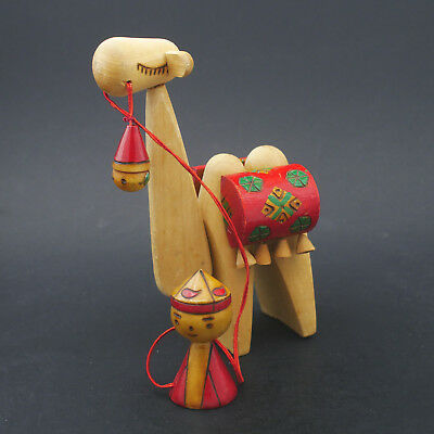 Contemporary modern bedouin and camel wooden figurine