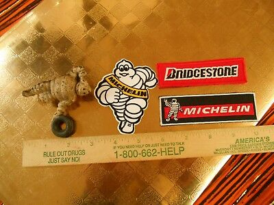 Michelin Cast Iron Michelin Man Tire Figure and 3 Iron on patches.