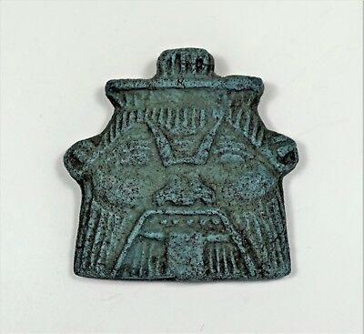 Egypt: A faience amulet of the god Bes, 3.5cm x 3.5cm.