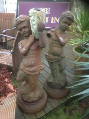 "Two Coalbrookdale style cast iron Cherub/Putti statues. 45"" tall x 17"" Dia base."