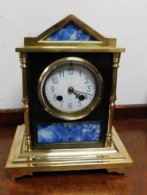 pretty small french brass  & ebonised striking mantel clock by benson london