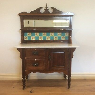Decoratively Carved Arts & Crafts Era Marble Top Washstand. Circa 1880.