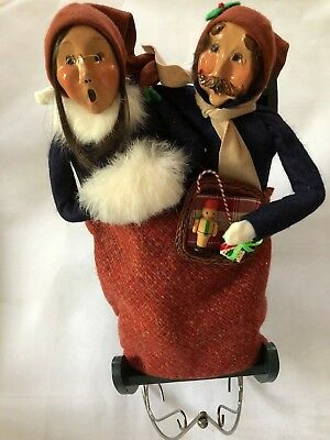 Retired Buyers Choice Caroler Couple In A Sled