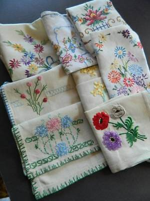 Eight (8) vintage Irish linen table toppers or tray cloths with hand embroidery