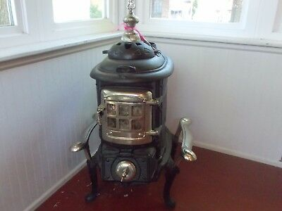 Antiques Parlor Stove Circa 1930.  Many of these were melted down for the WW II