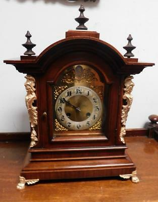 a junghans walnut and brass cased ting tang bracket clock