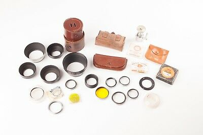 A Job Lot of 1950's Vintage Photographic Filters, Lens Hoods, Cases.