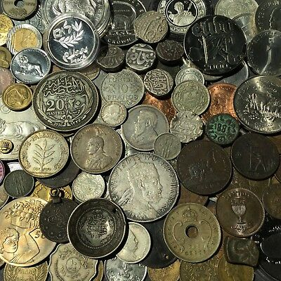 135 AFRICA AND ASIA COIN LOT with 2 small gold coins, included.