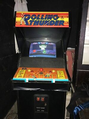 Vintage 1986 Atari Rolling Thunder arcade cabinet in good working condition.