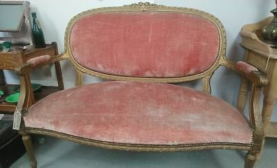 Antique Nineteenth Century French salon sofa with carved gilt frame
