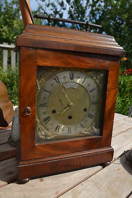 mahogony clock case with thwaites and reed dial