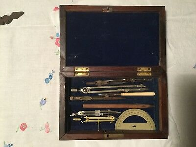 Antique drawing instruments in well kept early 19th century palisander box