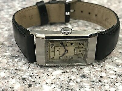 RARE STAINLESS STEEL  1930s OMEGA ART DECO ERA WITH ORIGINAL MIRROR DIAL WATCH.
