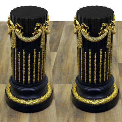 Ein PAAR SÄULEN schwarz-gold, ANTIQUE-FINISH pair of PEDESTALS, COLUMNS, PILLARS