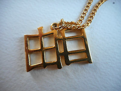 Vintage Signed R Petruccelli Chinese Character goldtone pendant on chain,24""